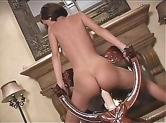 Beauty riding dildo while touching herself
