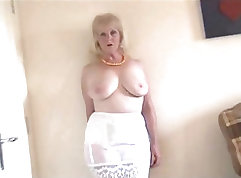 Busty mature in stockings masturbates in bed