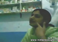 Black muscled doctor gives love potion to patient before his examination