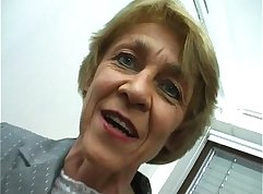 Blonde busted granny using toy on her titties