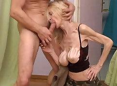 Amateur granny fucks a big glass dildo on webcam