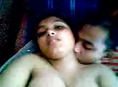 black girl is with her boyfriend on the bed, covering his lust